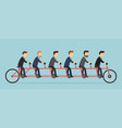 business people riding on a five-seat bicycle vector image vector image