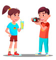 little boy takes a picture of a beautiful girl vector image vector image