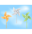 paper windmill in blue sky vector image