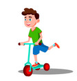 active little boy is riding a scooter vector image