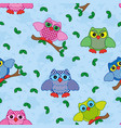 seamless pattern with ornamental owls over blue vector image vector image