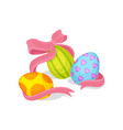 three painted easter eggs and pink bow spring vector image vector image
