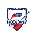 emblem with hockey sticks and puck equipment vector image