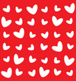 different pattern of white hearts on a red vector image