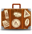 vintage brown travel suitcase with retro stick vector image