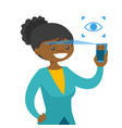 black woman scanning eyes with smartphone vector image