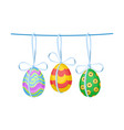 ornate easter eggs with bows hanging on rope vector image vector image