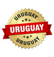 uruguay round golden badge with red ribbon vector image vector image