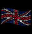 waving united kingdom flag pattern of crossing vector image vector image