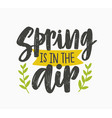 spring is in the air inspiring phrase written with vector image