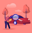 man looking on car through magnifying glass vector image vector image