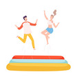 young man and woman bouncing on trampoline couple vector image