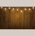 garland with light bulbs hanging on a wooden wall vector image