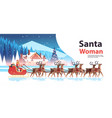 woman in santa claus costume riding sledge with vector image vector image