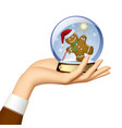 female hand holding a xmas snow globe with a vector image vector image