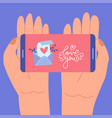 love message in phone screen two hands vector image
