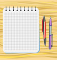 notebook red pen and purple pen vector image