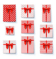 present boxes with red ribbon and big bow isolated vector image
