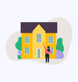 woman holding roller brush and painting a house vector image vector image