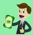 businessman holds money in his hand and has profit vector image vector image