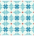 Geometric blue red ikat seamless pattern vector image