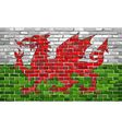 Flag of Wales on a brick wall vector image vector image