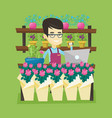 owner of flower shop talking on a phone vector image vector image