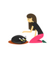 young woman sitting on the floor and stroking her vector image vector image