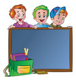 three boys standing behind a chalk board vector image vector image