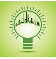Eco City inside of a green light bulb vector image