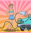 pop art young woman washing classic car with hose vector image vector image