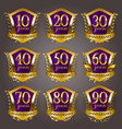 set of gold anniversary badges vector image