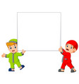 happy two moslem boy holding big blank sign vector image vector image