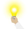 conceptual icon a light bulb in a hand man vector image vector image