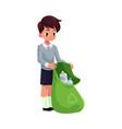 boy holding green bag of plastic bottles garbage vector image