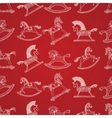 Christmas seamless pattern with rocking horses vector image vector image
