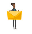 young african-american man holding a big envelope vector image