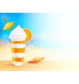 Glass of exotic orange cocktail on beach vector image