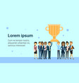 successful business people team holding golden cup vector image vector image