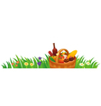 Picnic basket in the grass vector image vector image