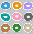 Graduation cap symbols Multicolored paper stickers vector image