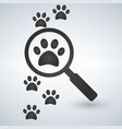 magnifying glass over the footprints vector image vector image