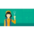 Woman pointing at light bulb vector image vector image