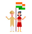 a happy couple is standing by the flag of india vector image