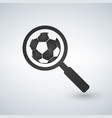 magnifying glass with soccer ball icon football vector image vector image