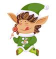 christmas elf or santa helper with lollipop icon vector image vector image