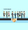 two business men team leaders shaking hands over vector image vector image