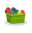 green plastic container full of children toys vector image vector image