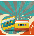 Two vintage tape cassettes and music notes vector image