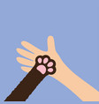Hand arm holding cat dog paw print leg foot close vector image